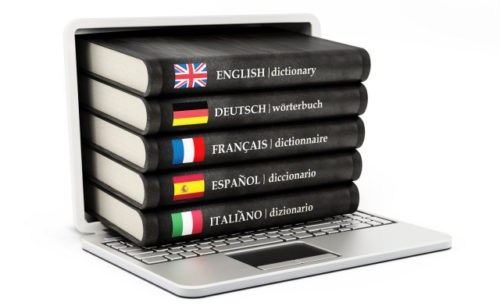 Dictionaries inside  laptop computer screen isolated on white background